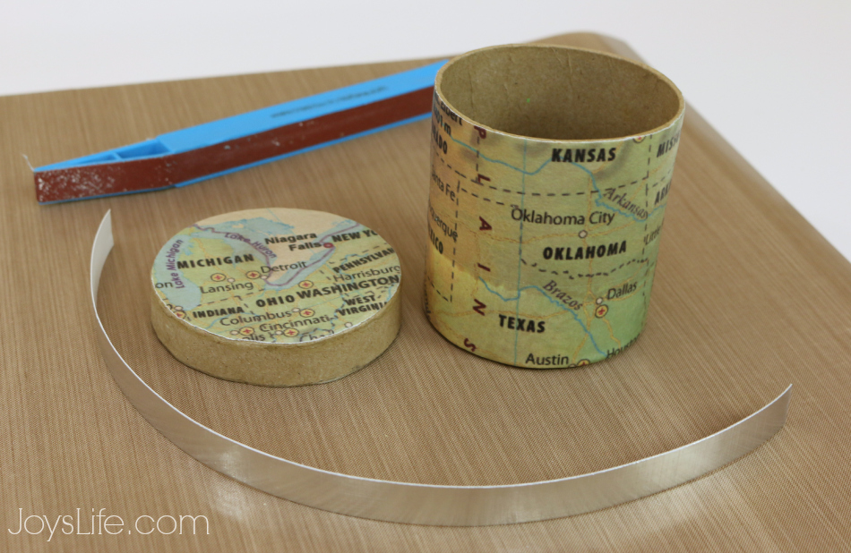 Embossing Foil Cardstock for a Decorative touch to this Mod Podge  Map Box