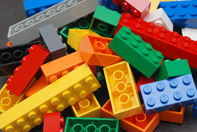 A pile of Lego blocks, of assorted colours width=
