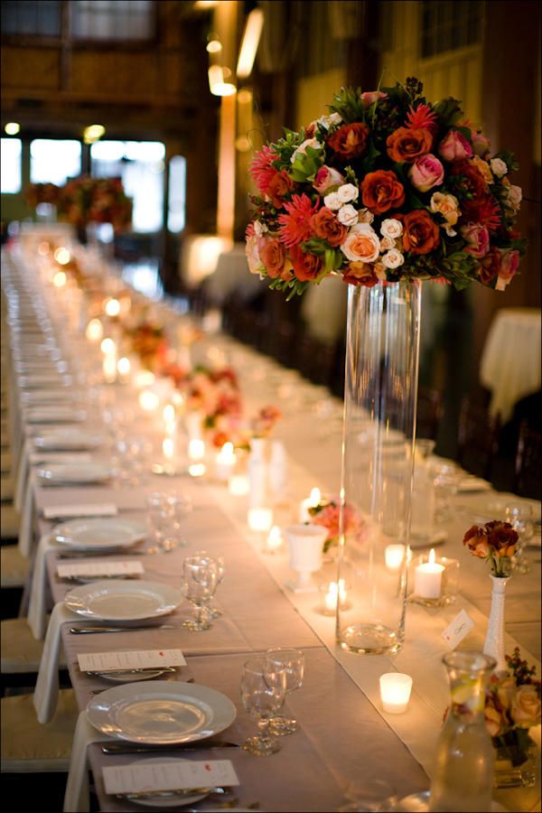 Romantic wedding reception seating arrangement with flowers and