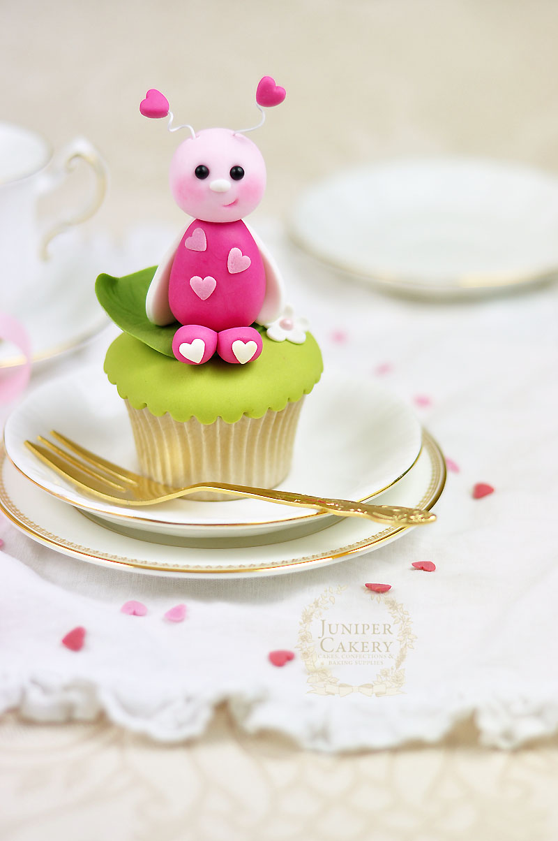 Valentine's Day cupcake decorating tutorial on how to make a cute edible love bug from Juniper Cakery