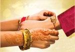 Sister tying Rakhi