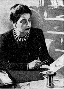 Marie El-Khoury, 1940. She is surrounded by the tools of her trade and wearing a necklace of her own design.