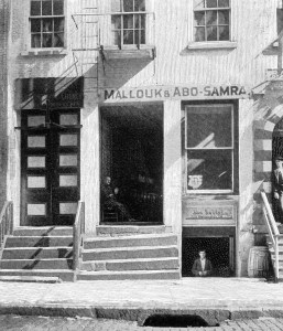 Mallouk & Abo Samra Dry Goods and John Haddad's Grocery in basement, 77 Washington, 1904