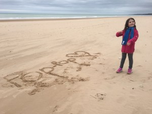 little girl drawing in the sand, great-granddaughter of WWII veteran, the beaches of normandy, beaches of normandy, D-Day