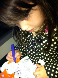 little girl coloring on a plane