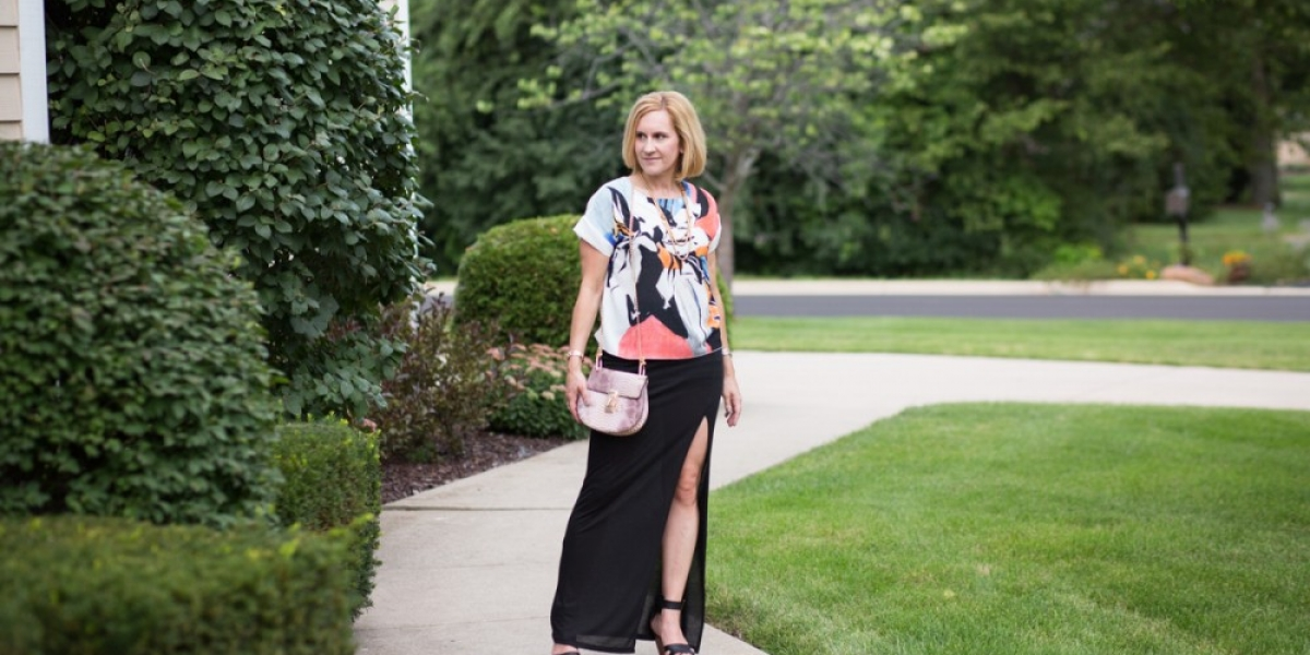 An 80's vibe look featuring a graphic flower top and snakeskin bag from Make Me Chic.