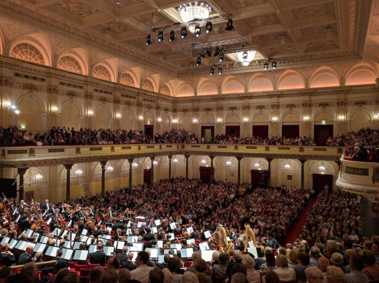 orchestra and audience in concert hall