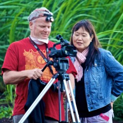 Director Danny Miller and Executive Producer Patsy Y. Iwasaki in a Maui canefield to film a fire. Photo by Baron Sekiya
