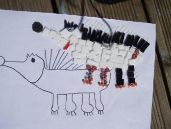 Child's work. Glued tiles on mesh.