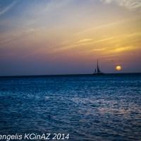 Lone Sail at Sunset