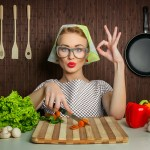 Happy woman cook with okay sign cut carrot-vintage concept