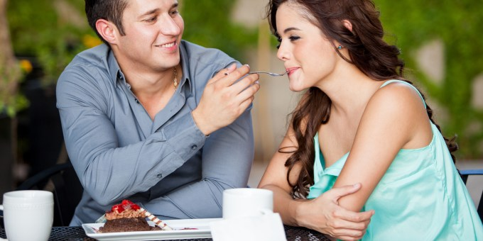 happy-hispanic-couple-sharing-2