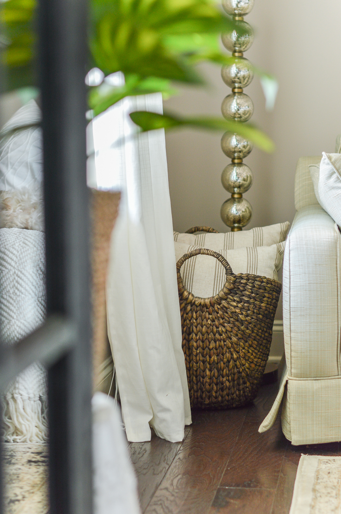 11 Ways to Use Baskets for Storage and Decor in Your Home - Kelley Nan - living room blanket storage