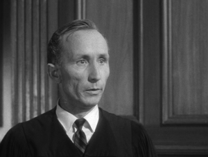 Ken Drake in The Outer Limits episode, I, Robot as the judge.