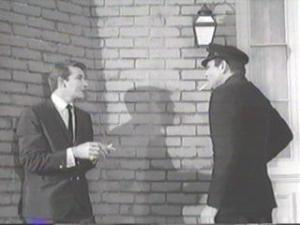 """Richard Dawson (left) with Don Gordon in The Outer Limits episode, The Invisibles. One of the better episodes. Aliens plan to take over the U.S. by recruiting disaffected loners, who are practically """"invisible"""" to U.S. authorities. Each invisible is para-sited by a fish-like creature who adapts and controls the human. A U.S. government agent infiltrates the cats' paws, who are to get close to powerful U.S. government officials and transfer the creatures into the officials."""