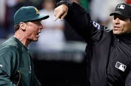 Umpire Angel Hernandez throws A's Manager Bob Melvin out of the game rather than listen to how he screwed up.