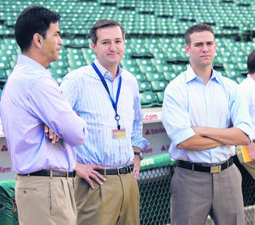 This is the brain trust Cubs fans are forced to trust as the franchise razes the big league club to build a new team.  How are they doing? (From left, Senior Vice-President/Scouting and Player Development Jason McLeod, Tom Ricketts, and Theo Epstein)