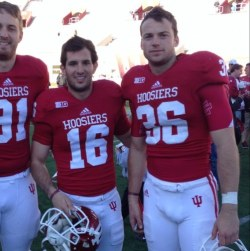 Indiana punter Erich Toth (36) stands with fellow specialist Mitch Ewald (16).
