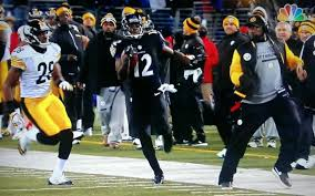 Mike Tomlin moves into and out of the path of Jacoby Jones - a choice that cost him $100K.