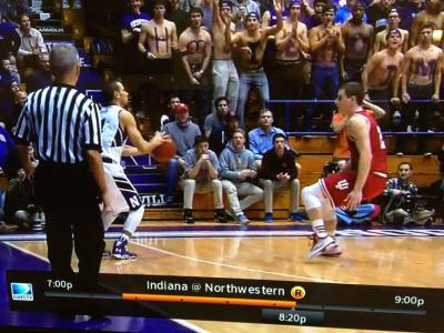 Hands down during a defensive closeout allowed Northwestern's Tre Demps to make the three-point shot that resulted.