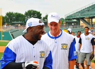 Robert Mathis and Peyton Manning laugh at one of the previous celebrity softball games held to benefit the Indiana Children's Wish Fund.