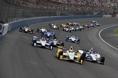 Simon Pagenaud leads the field into Turn 1 at the start of the MAVTV 500 at Auto Club Speedway -- Photo by IndyCar