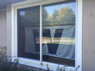 When the Cubs win, the W flag hangs in the window of the Sterling home - until we get a flagpole.