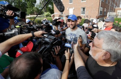 Andrew Luck faces a media throng as he arrives in Anderson for his fifth training camp.