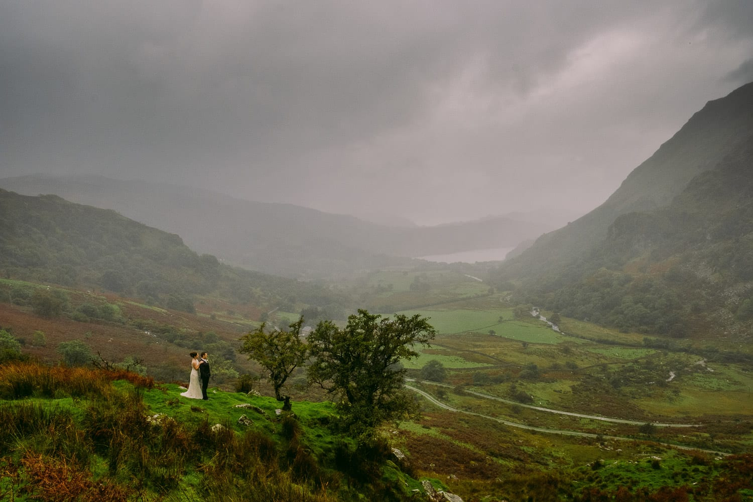 An epic portrait of the bride and groom in the mountains