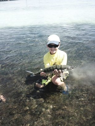 Butchie Hewlett nabs his first bonefish while fishing 'wet pants' style. He also won the top junior angler award while fishing with his Uncle Squeak.