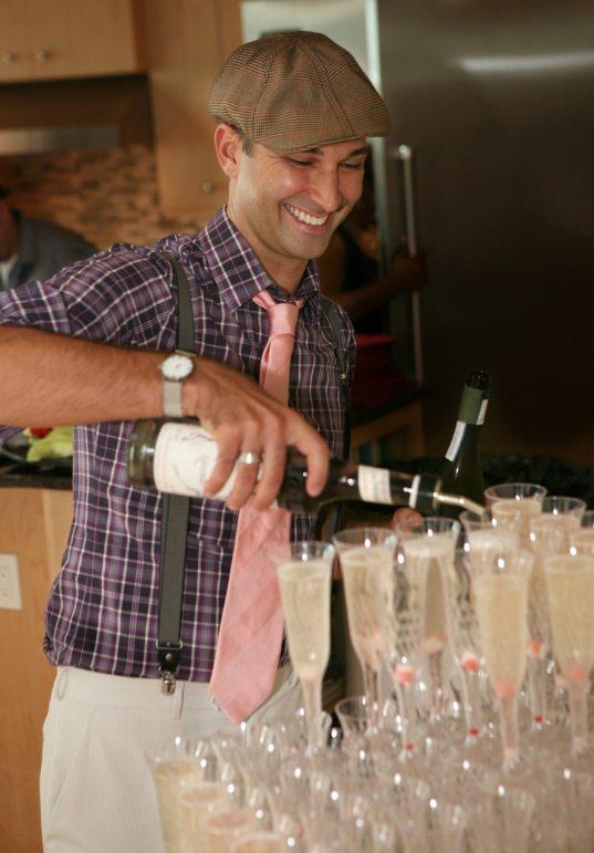 Kaleb Smith pours the bubbly.