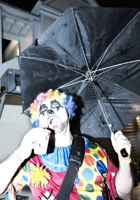 Sad clown Ed Von pleads with the rain to stop.