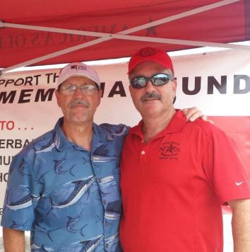 Brothers Gary Noe and Kevin Piper work the booth at Looe Key Tiki Bar to raise awareness about safety when diving.