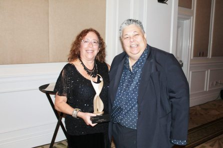 Chamber Board member Melissa Kendrick, right, mixed humor and grace to present Dolphin Research Center's Rita Irwin with the Athena Leadership award.