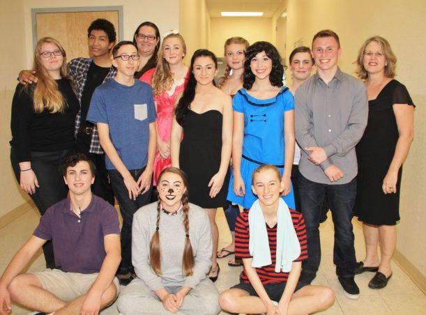 """The cast and crew of """"Charlie Brown"""" right before the show starts. John Galjanic, sitting left, Mackenzie Helms, and Hannah Gracy. Autumn Tipsword, standing left, Michael Macko, Eddie Hannah, Lesley Bollig, Ariana Patterson, Natalie Ehrig, Andie Devitt, Claire McCarthy, Zach Perry, Christopher Freeman and musical director Lyn Cox."""