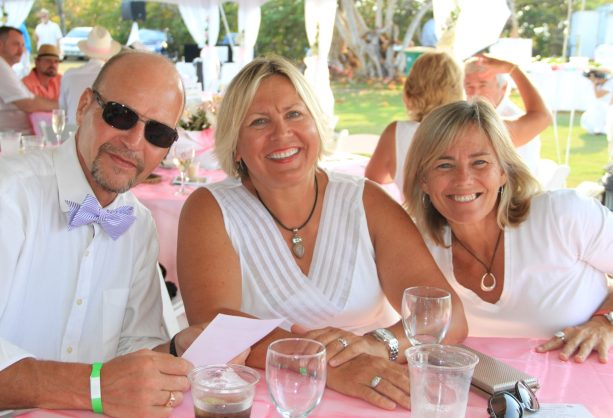 Jussi Halmetsalo, County Commissioner Heather Carruthers and Lisa Tennyson enjoy the event.