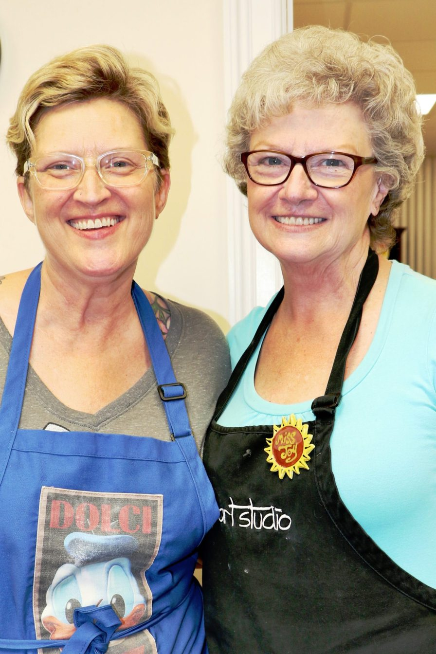 Art Studio Owner Shelia Cook donates all the proceeds from the hat and headband making to the Fishermen's Hospital Foundation. She is seen here with her mom, Joy Elledge.