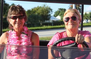 Suzy Curry, left, and Charlotte Quinn, share a ride — their privilege as event organizers. Curry chaired the walk in 2015 and Quinn will chair in 2016.
