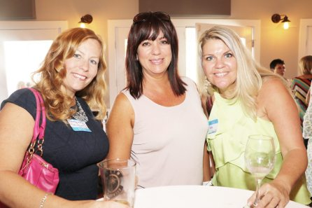 Kathryn Watkins, left, Amber Debevec and Yvette Castoeman catch up with each other at the event.