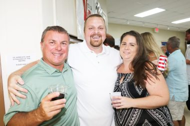 UPS Store's Arno Silva, left, is ready to receive the award for best community-minded business. He's pictured here with John and Michelle Ludwig.