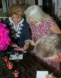 Artist Janice Nicowski shows Peary Fowler a picture of the seven-feet-tall papier-mâché can-can girls she's creating for the event. Last year, her giant 'Oscar' was a big hit.