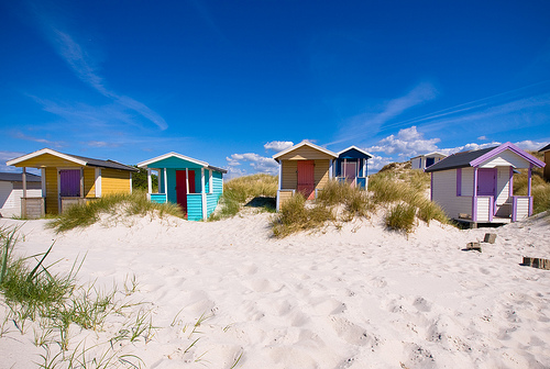 The colorful beach huts and impossibly white sands of Skanör beach, Sweden