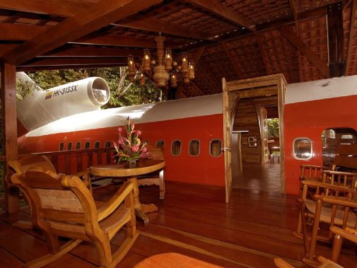 Enjoy happy hour pretending you're at 30,000 feet in this 727 rental.