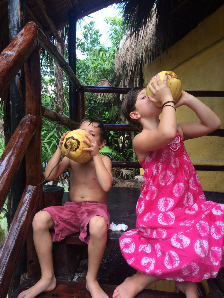 Merrit and Riley enjoying some fresh coconut juice in Tulum.