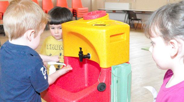 Nursery children enjoy hand washing lessons