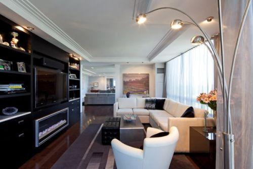 Kê nội thất theo hướng vuông góc với chiều dài cũng giúp khắc phục nhược điểm của phòng khách dài.