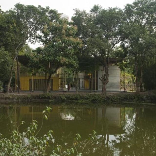 54e67d8ee58ece33a800004c_pani-community-centre-schilderscholte-architects_pani_community_centre_bangladesh_west_facade_view_with_pond_schilderscholte_a-530x352 (Copy)