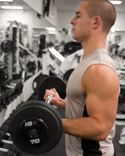 15396-a-healthy-young-man-lifting-weights-in-a-gym-pv