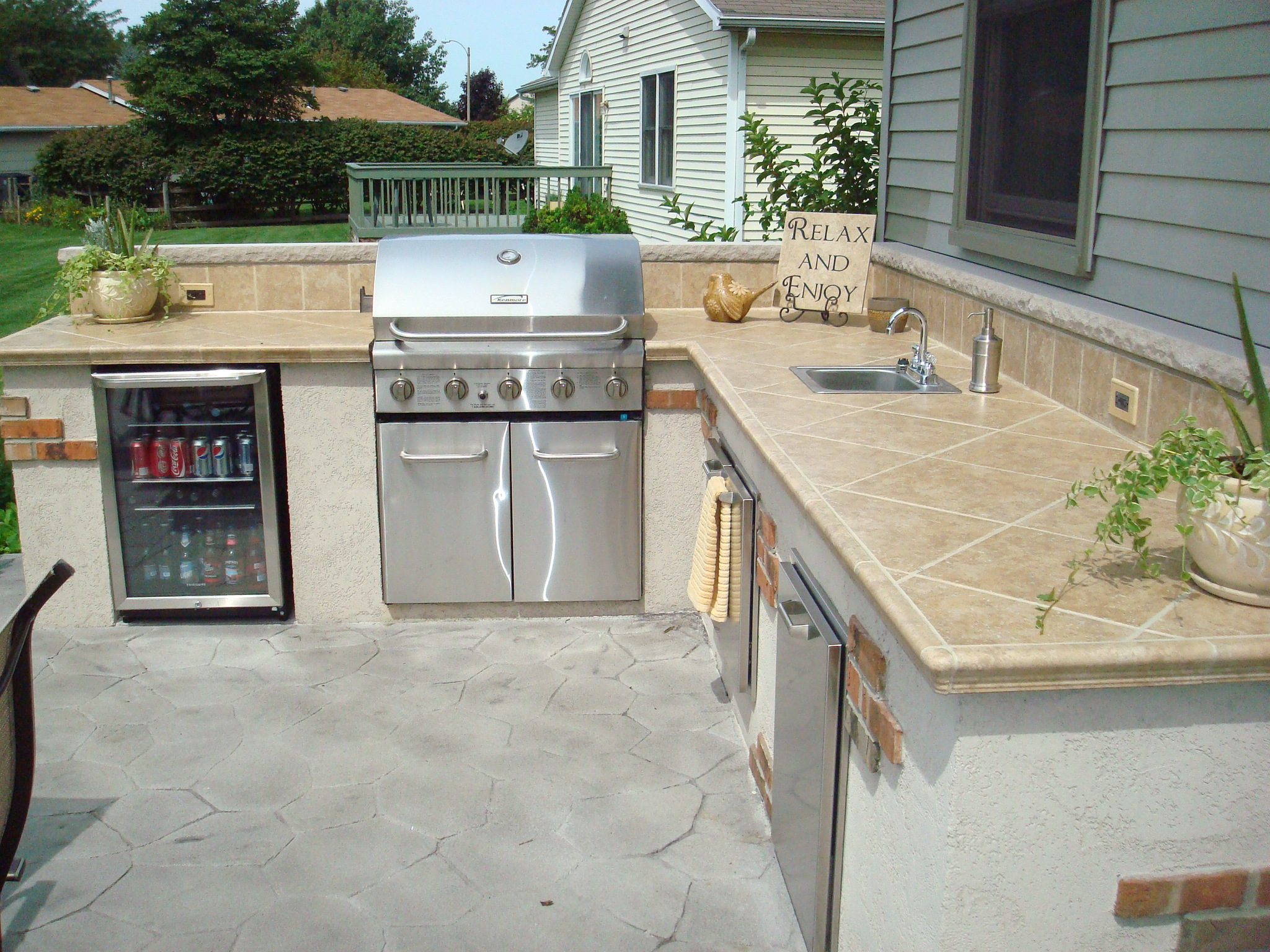 Outdoor living kirk wylie masonry for Outdoor kitchen grill cabinets