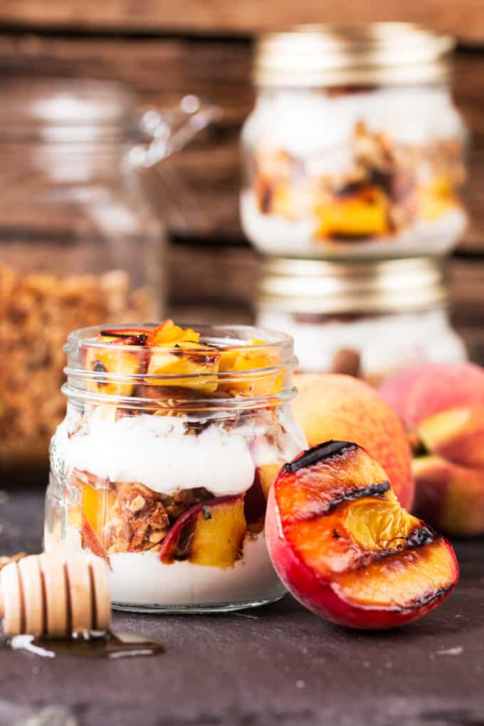 Crunchy homemade granola, layered with Greek yogurt, and caramelized peaches. Cook the peaches the night before on the residual heat from your BBQ, and you'll have the BEST breakfast the next day.